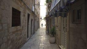 Handheld tracking shot a rustic narrow alleyway in Dubrovnik. Croatia stock video