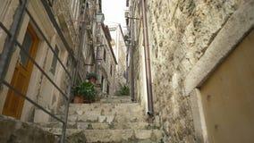 Handheld tracking shot a rustic narrow alleyway in Dubrovnik. Croatia stock video footage