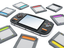 Handheld video game device and retro game cartridges.  Stock Photos