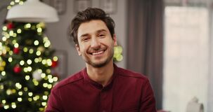 Handheld view of smiling man in Christmas time