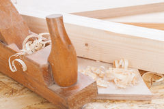 Handheld wood plane with wood shavings Royalty Free Stock Photo