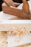 Handheld wood plane with wood shavings Stock Photo