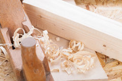 Handheld wood plane with wood shavings Stock Images