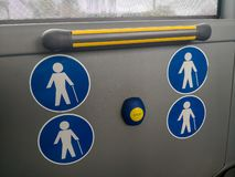 Handhold with note signs in public transport stock photos