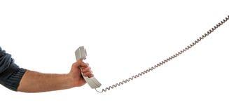 Handholding getelegrafeerde telefoon royalty-vrije stock afbeelding