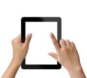 Handholding och trycka på på tablet-PCen Arkivfoton