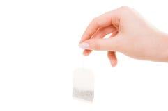 Handholding-Teebeutel Lizenzfreies Stockbild