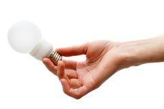 handholdingen förde lightbulben royaltyfri fotografi