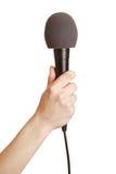 Handholdingmikrofon oben Lizenzfreie Stockbilder