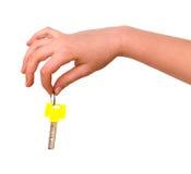 Handholdingtaste mit gelbem Bogen lizenzfreie stockbilder