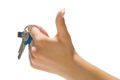 Handholdingtasten, die sich Daumen zeigen Stockfotos