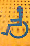 Handicap access on yellow background Royalty Free Stock Photography