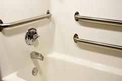 Handicap bathtub. Chrome grab safety bars in a handicap bathtub royalty free stock photo