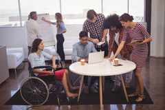 Handicap business people with colleagues in creative office Stock Image