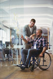 Handicap businessman discussing with colleague at office Royalty Free Stock Photography