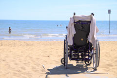 Handicap chair at seaside Royalty Free Stock Photos