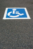 Handicap, disabled parking sign painted on the asphalt Stock Photography