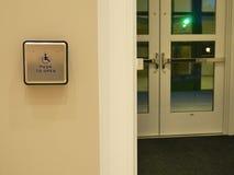 Handicap Door Button. Large handicap door button is marked push to open for automatic door opening Royalty Free Stock Image