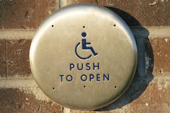Handicap door push button Royalty Free Stock Photography