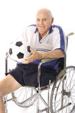 Handicap elderly man with soccer ball vertical royalty free stock images