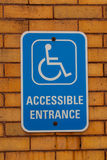 Handicap Entrance Sign. Mounted on a brick wall Stock Photography
