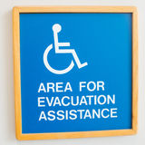 Handicap evacuation warning sign on the wall Royalty Free Stock Images