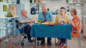 Handicap grandfather and family having dinner