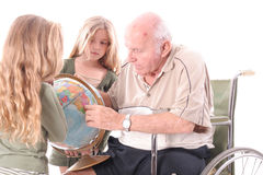 Handicap grandfather showing children the world. Isolated on white Royalty Free Stock Photo