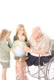Handicap grandfather showing children the world. Isolated on white Royalty Free Stock Photos