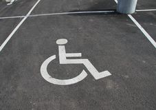 Handicap icon. Parking lot with handicap sign and symbol. Empty handicapped reserved parking space with wheelchair symbol. Disable. D person sign. Copy space Royalty Free Stock Photos