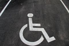 Handicap icon. Parking lot with handicap sign and symbol. Empty handicapped reserved parking space with wheelchair symbol. Disable. D person sign. Copy space Royalty Free Stock Photo