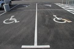 Handicap icon. mother with kid symbol. Handicap icon. Parking lot with handicap sign and symbol. Empty handicapped reserved parking space with wheelchair symbol Stock Images