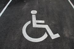 Handicap icon. Parking lot with handicap sign and symbol. Empty handicapped reserved parking space with wheelchair symbol. Disable. D person sign. Copy space Royalty Free Stock Images