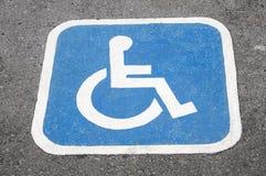 Handicap logo on street. Road Stock Image