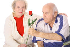 Handicap Man Giving His Wife A Rose Stock Photo