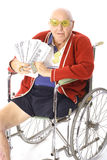 Handicap man with lots of money. Isolated on white Stock Images