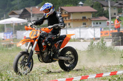 Handicap Motorsports. TAXENBACH, AUSTRIA - JUN 5: Supermoto trophy race. Famous disabled sports athlete Robert Friedrich at the exhibition race on June 5, 2011 Royalty Free Stock Photography