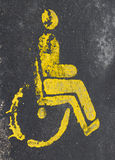 Handicap park. Yellow road sign handicap park Royalty Free Stock Photography