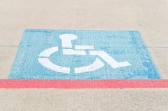 Handicap Parking. Handicap symbol painted on a parking space Stock Photos