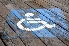 Handicap Parking. Sign on the planksl of the Santa Monica Pier in Southern California Royalty Free Stock Photography