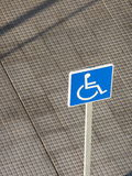 Handicap Parking. Sign in parking lot with urban pavement in background Royalty Free Stock Photo