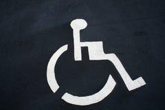 Handicap parking. Symbol in parking lot Stock Photography