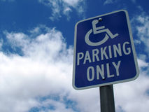 Handicap Parking in Heaven. Handicapped parkign sign against blue clouded sky stock photo