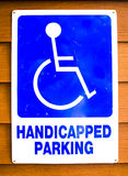 Handicap parking old sign. On wood background Stock Photo
