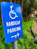 Handicap parking sign. Handicap parking  sign in a green forest Stock Photo