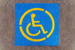 Handicap parking sign on asphalt, persons with disabilities Royalty Free Stock Photography