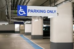 Handicap parking only sign. Blue Handicap Parking Only Sign For Disabled Drivers Stock Photos