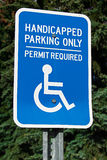 Handicap parking sign with trees in the background Royalty Free Stock Images