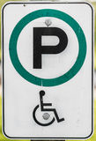 Handicap Parking Sign. Unusual handicap parking sign with green circle instead of the standard blue. Includes handicapped wheelchair symbol Stock Photography