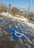 Handicap parking space with ice and snow Royalty Free Stock Photos